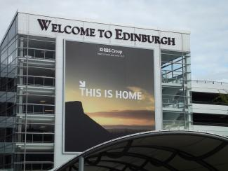Edinburgh Airport image with RBS welcome poster